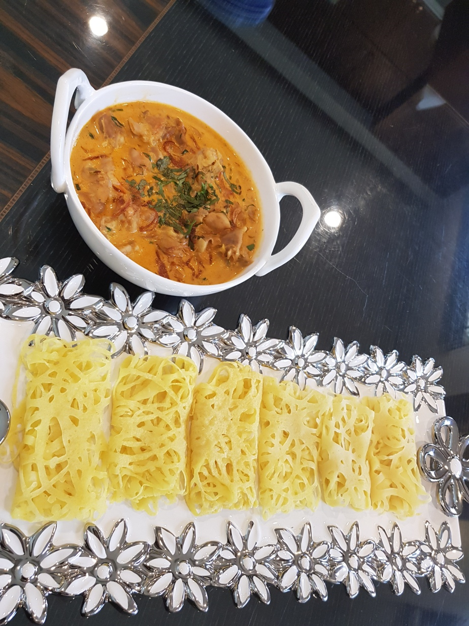 Roti jala/ lacy crepes  with chicken curry